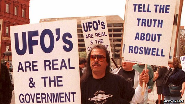A UFO protestor stands outside the GAO building in Washington, DC, in 1995.