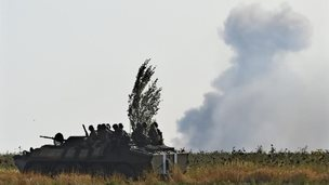 Ukrainian army vehicle and rebel shellfire in Mariupol, September 2014