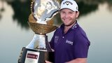 Branden Grace with the Qatar Masters trophy
