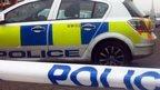 Police car and cordon