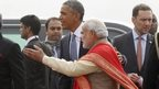 President Barack Obama is greeted by Indian Prime Minister Narendra Modi at Delhi airport