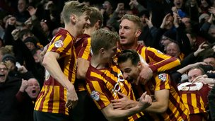 Bradford's Filipe Morais celebrates with his teammates after scoring a goal during the English FA Cup