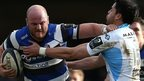 Bath blind-side flanker Matt Garvey hands off Glasgow full-back Sean Maitland