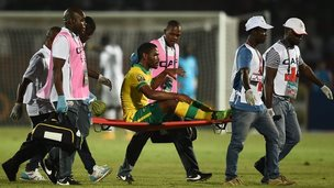Thulani Hlatshwayo is stretchered off during South Africa's match against Senegal