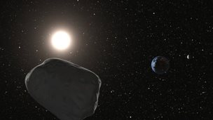 An image of an asteroid and Earth