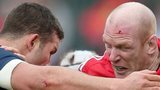 Mark Easter of Sale  tackles Munster's Paul O'Connell