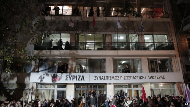 Supporters gather outside the headquarters of the Syriza party in Athens