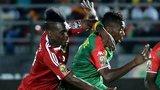 Thierry Bifouma (L) challenges Burkina Faso's defender Steeve Yago and Burkina Faso's defender Mohamed Koffi