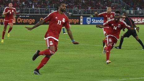 Javier Balboa (left) celebrates scoring the first goal for Equatorial Guinea