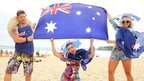 Beachgoers pose on Bondi beach as part of the 2014 Australia Day Celebrations on January 26, 2014 in Sydney, Australia.