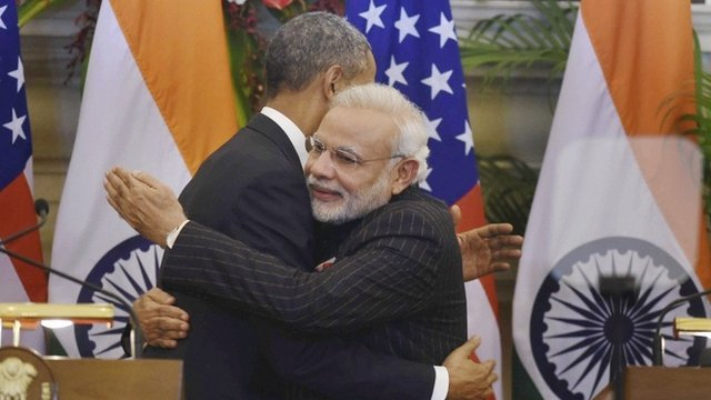 President Barack Obama, left and Indian Prime Minister Narendra Modi hug after they jointly addressed the media following their talks, in New Delhi, India, Sunday, Jan. 25, 2015