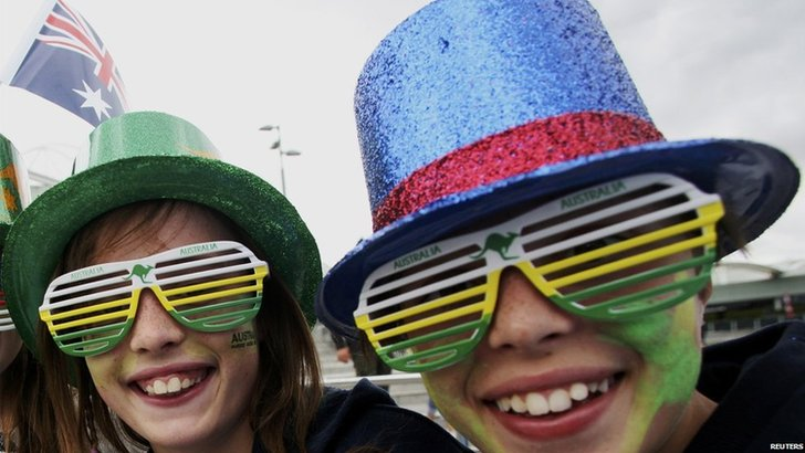 Two tennis fans wear colourful hats and glasses as part of Australia Day celebrations in Melbourne on 26 January, 2015