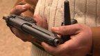 Teacher holds gun