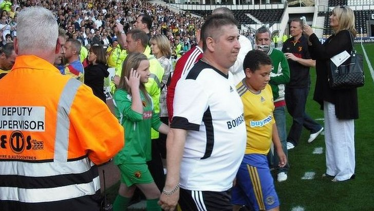Nigel Callaghan led out the sides for a benefit match in 2010 as part of his fight against bowel cancer