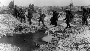 British troops head to their trenches during World War One