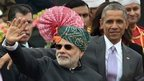 "US President Barack Obama (R) and Indian Prime Minister Narendra Modi (L) wave to spectators after attending India""s Republic Day parade on Rajpath in New Delhi on January 26, 2015."