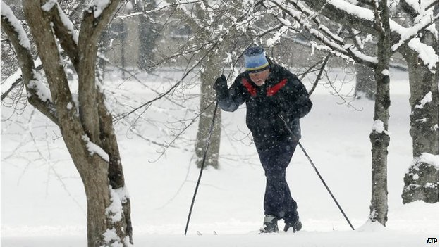 Man using cross-country skis on the Esplanade in Boston, 24 January 2015