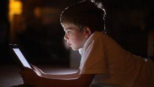 boy looking at tablet