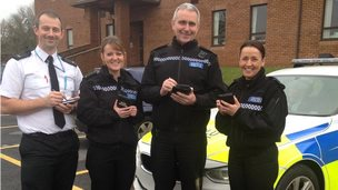 Dyfed-Powys Police officers with their smart phones