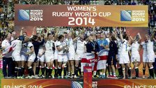 England's players celebrate with the trophy after winning the IRB Women's Rugby World Cup final match between England and Canada at the Jean Bouin Stadium in Paris on August 17, 2014