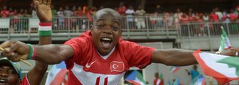 An Equatorial Guinea fan celebrates his side's victory over Gabon that took them to the quarter-finals