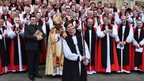 Libby Lane surrounded by other bishops