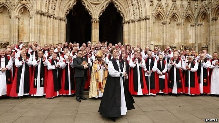 Bishop Libby Lane surrounded by other bishops