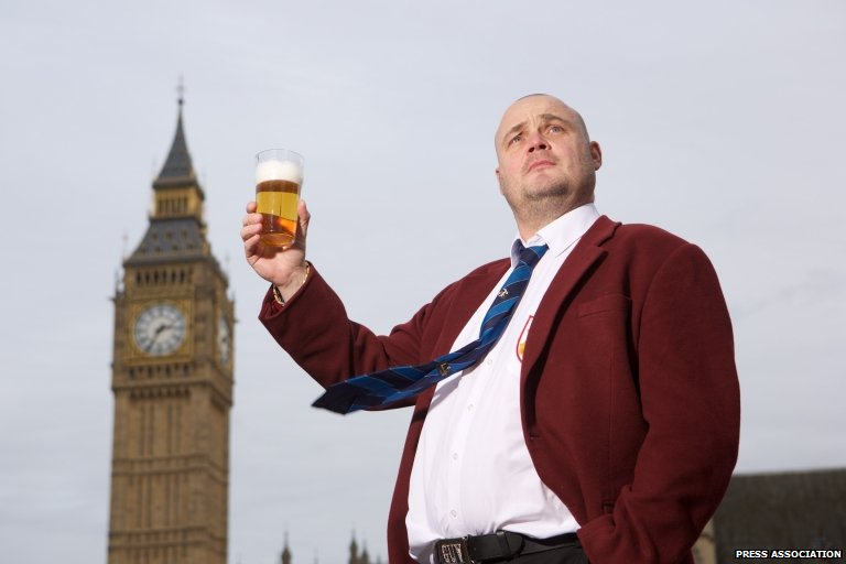Al Murray holding a pint of beer
