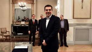 Alexis Tsipras smiles after being sworn in as prime minister of Greece, 26 January