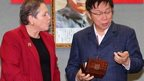 Taipei Mayor Ko Wen-je receives a gift of a watch from visiting British Transport Minister Baroness Susan Kramer