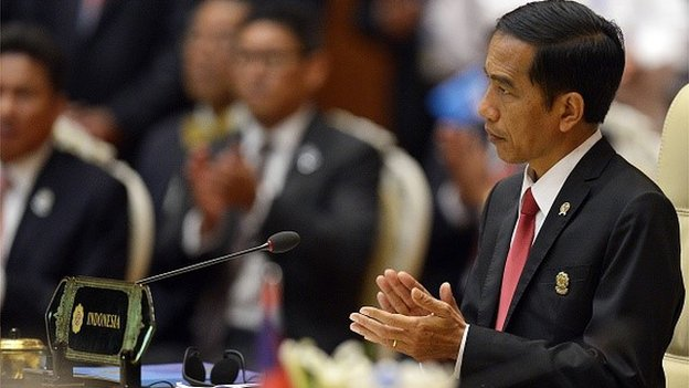 Indonesian President Joko Widodo applauds during the plenary session of the 25th ASEAN Summit at the Myanmar International Convention Center in Myanmar's capital Naypyidaw on November 12, 2014