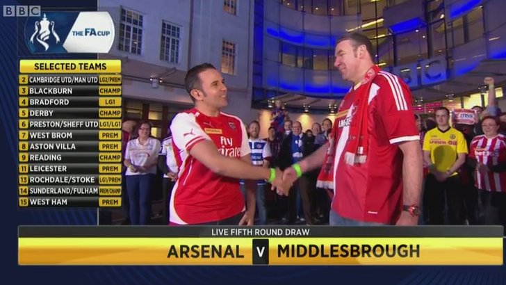 Arsenal fan shakes Middlesbrough fan's hand