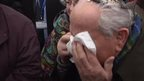Auschwitz survivor crying