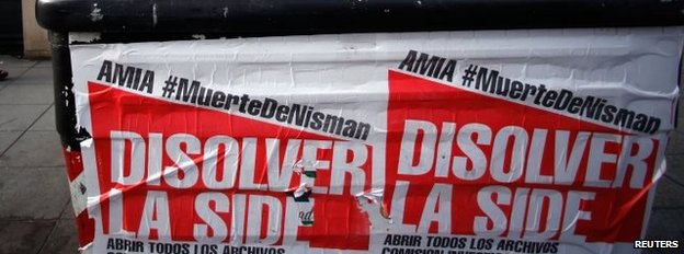"""Posters on a rubbish container read """"Dissolve the Side"""""""