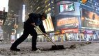 Man shovelling snow in Times Square