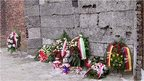 Wreaths laid against the 'Death Wall' at Auschwitz