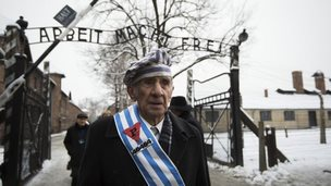 Survivors walk out of the gate at Auschwitz, 27 January 2015