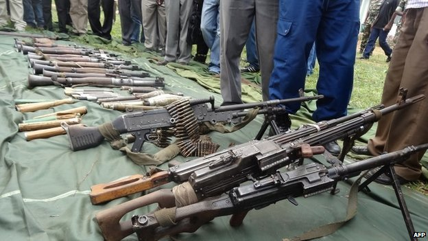 Burundian army men present on 6 January 2015 in Cibitoke, arms they say they they captured from rebels in the north-western part of the country.