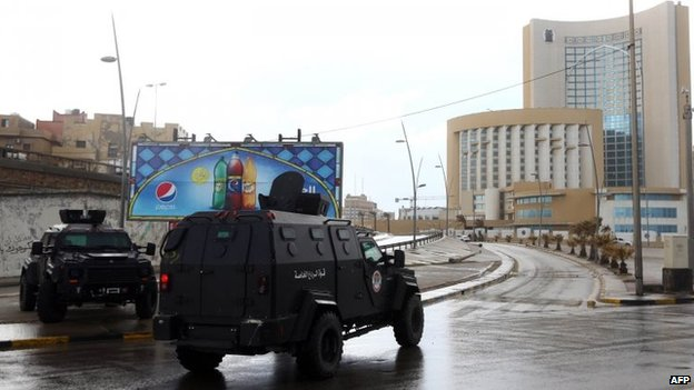 Libyan security forces and emergency services surround Tripoli's central Corinthia Hotel (right), 27 January 2015