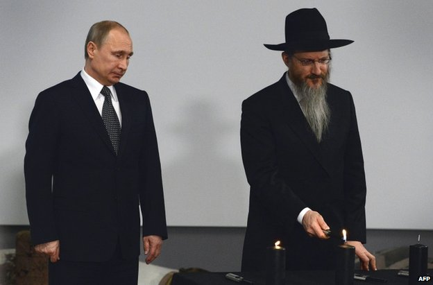 Russian President Vladimir Putin (left) attends ceremony in Moscow with Russia's Chief Rabbi, Berel Lazar, 27 January