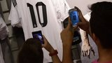 Fans taking pictures of new signing's shirt