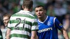 Celtic's Charlie Mulgrew and Lee McCulloch of Rangers exchange views