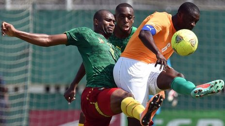 Cameroon's Leonard Kwekeu (left) and Ivory Coast's Yaya Toure battle during the Nations Cup qualifiers