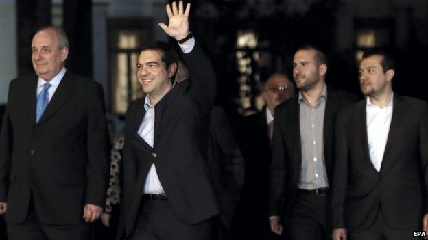 PM Alexis Tsipras (left of centre) with members of his new cabinet - 27 January
