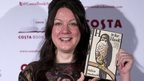 Helen Macdonald holding her book H is for Hawk