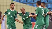 Riyad Mahrez (left) is congratulated after scoring for Algeria