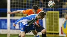 Coleraine's Ian Parkhill fights out an aerial challenge with Glenavon's Conor Dillon