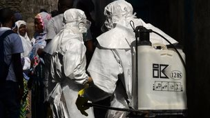 Workers prepare for burial for victims of Ebola virus, in Monrovia, Liberia. 5 January 2015