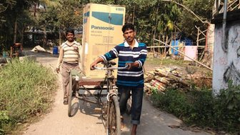 the fridge arrives - on a bicycle