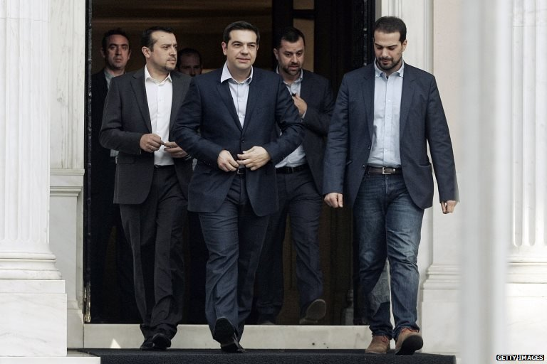 "Greece""s Prime Minister Alexis Tsipras is accompanied by associates"